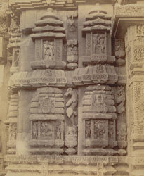 Close view of sculptures at base of left half of north façade of the Brahmeshvara Temple, Bhubaneshwar